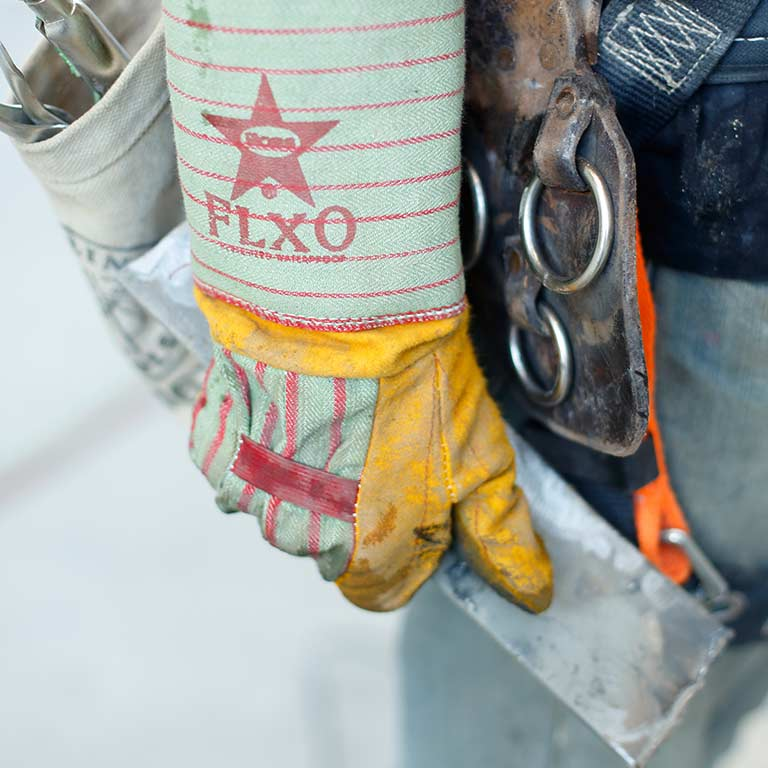 Close-up of a construction worker's glove