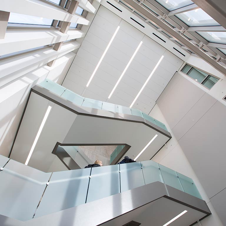 Students walk up a staircase in the School of Public and Environmental Affairs Building.